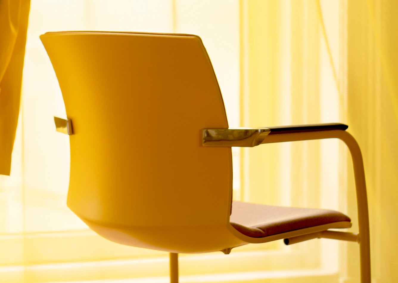 Royal Ahrend Well cantilever chair in yellow at Kvadrat store in Amsterdam
