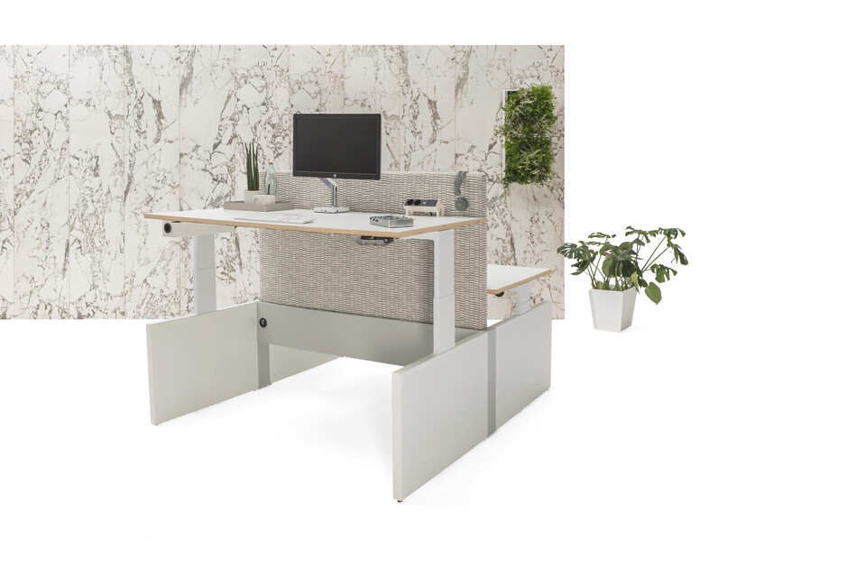 Gispen Cimo dual table with white frame and mono linkable panel legs with white chipboard tabletops and front one in position 130 and grey upholstered screen straight thick and white marble patern backpanel front right view